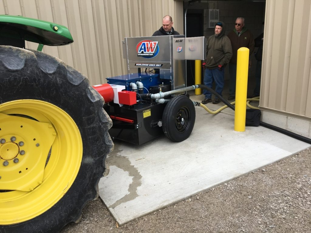 Three men running a tractor on an AW Dynamometer AG PTO Dynamometer